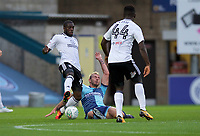 Aboubakar Kamara of Fulham is tackled by Max Muller of Wycombe Wanderers during the Carabao Cup match between Wycombe Wanderers and Fulham at Adams Park, High Wycombe, England on 8 August 2017. Photo by Alan  Stanford / PRiME Media Images.