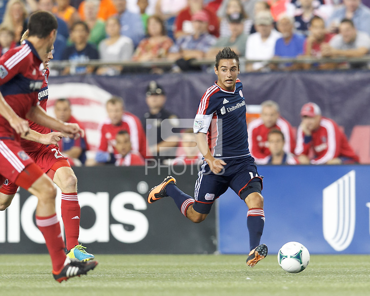New England Revolution midfielder Diego Fagundez (14) looks to pass. In a Major League Soccer (MLS) match, the New England Revolution (blue) defeated Chicago Fire (red), 2-0, at Gillette Stadium on August 17, 2013.