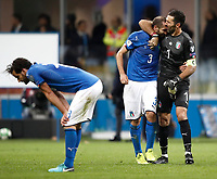 Soccer Football - 2018 World Cup Qualifications - Europe - Italy vs Sweden - San Siro, Milan, Italy - November 13, 2017 <br /> Italy's Marco Parolo (l), Giorgio Chiellini (c) and Captain Gianluigi Buffon (r) look dejected at the end of the FIFA World Cup 2018 qualification football match between Italy and Sweden at the San Siro stadium in Milan, on November 13, 2017. <br /> Italy failed to reach the World Cup for the first time since 1958.<br /> UPDATE IMAGES PRESS/Isabella Bonotto