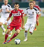 CARSON, CA – July 9, 2011: Chicago Fire midfielder Marco Pappa (16) and LA Galaxy defender Bryan Jordan (27) during the match between LA Galaxy and Chicago Fire at the Home Depot Center in Carson, California. Final score LA Galaxy 2, Chicago Fire FC 1.