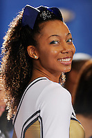 14 November 2008:  An FIU cheerleader flashes a smith during the FIU 57-54 victory over Eastern Kentucky at FIU Arena in Miami, Florida.
