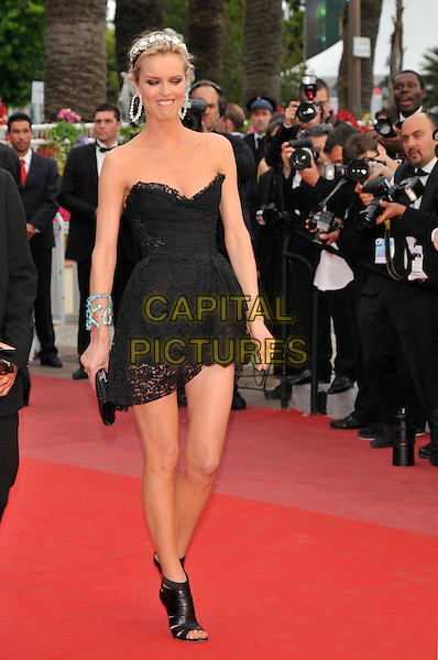 EVA HERZIGOVA.'La Princesse de Montpensier' premiere at the 63rd International Cannes Film Festival, Cannes, France, .16th May 2010..full length dress strapless black cleavage jewelled gem encrusted embellished crystals headband head hair band hairband lace mini walking open toe shoes booties shooboots ankle boots  .CAP/PL.©Phil Loftus/Capital Pictures.