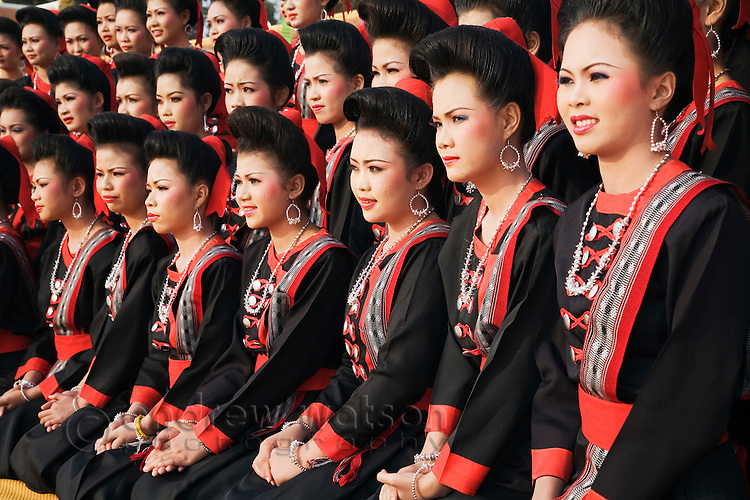 Young dancers adorned in traditional Isan dress during the festival of Ok Phansa, celebrating the end of the Buddhist Rains Retreat.  That Phanom, Nakhon Phanom province, THAILAND.