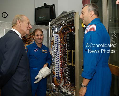 "Prince Philip, left,  speaks with veteran space walkers John M. Grinsfeld, center,  and Michael J. Massimino at NASA's Goddard Space Flight Center.  Photo Credit: ""NASA/Chris Gunn"""