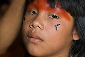 Xingu Indigenous Park, Mato Grosso State, Brazil. Aldeia Morena; young girl with urucum and genipapo face paint.