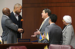 Nevada Sens., from left, Kelvin Atkinson, Aaron Ford, Michael Roberson, Ruben Kihuen and Debbie Smith talk on the Senate floor at the Legislative Building in Carson City, Nev., on Wednesday, April 15, 2015.<br /> Photo by Cathleen Allison