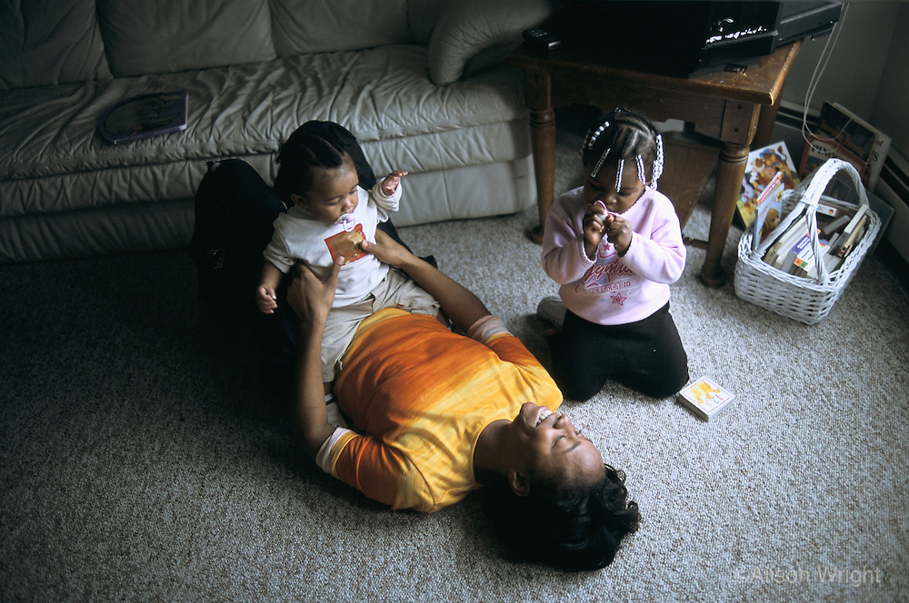 Minnesota, Minneapolis. Working mothers with their children.