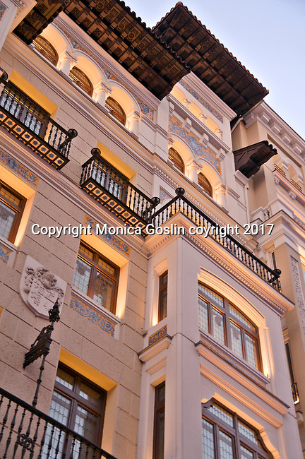 Looking up at the buildings along the Gran Via, a shopping street in the historical city center