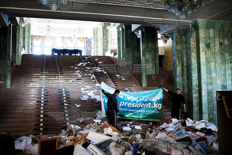 Men clean in the White House. During the 7th April 2010 uprising, President Kurmanbek Bakiyev was overthrown and this palace was looted and fires were lit.