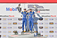 #81 BimmerWorld Racing, BMW 328i, ST: Nick Galante, Devin Jones celebrates the win on the podium