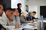 "MEDENINE - TUNISIA - 14 March 2012 -- European Training Foundation (ETF) / Tunisian Ministry of Vocational Training and Employment (MFPE) -  ""Human Capital for Regional Socio-Economic Development (Medenine, Tunisia)"" - Project Launch Workshop - Workshop attendee Abderrazak SOUAI, Gabes University (Center, white headscarf) listens to the workshop presentation -- PHOTO: Lindsay MACKENZIE / EUP-IMAGES.."