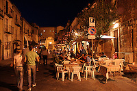 Vita notturna in via Sant'Anna a Castelbuono..Castelbuono is a town and comune in the province of Palermo, Sicily (southern Italy). It is especially famous for the castle which its name derives, and around which the city grew up in the 14th century. Night life in Sant'Anna street.
