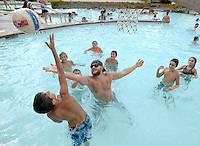 NWA Democrat-Gazette/BEN GOFF @NWABENGOFF<br /> Visitors play basketball on Sunday Sept. 6, 2015 at the Rogers Aquatic Center. The water park will be open for the last day of the 2015 season on Monday from 11:00a.m. to 7:00p.m.
