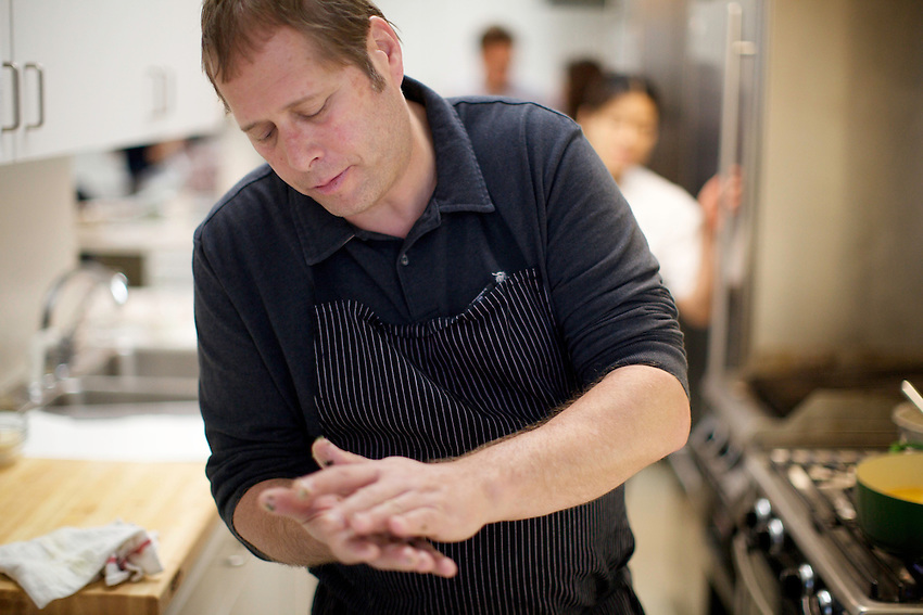 NEW YORK, NY - MAY 21, 2011: Manresa chef, David Kinch, forms savory beignets in the Bon Appetit Test Kitchen. CREDIT: Clay Williams for Bon Appetit.<br /> <br /> &copy; Clay Williams - http://claywilliamsphoto.com