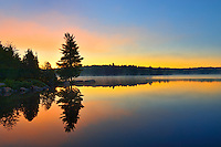 Reflection at dawn at Smoke Lake<br /> Algonquin Provincial Park<br /> Ontario<br /> Canada