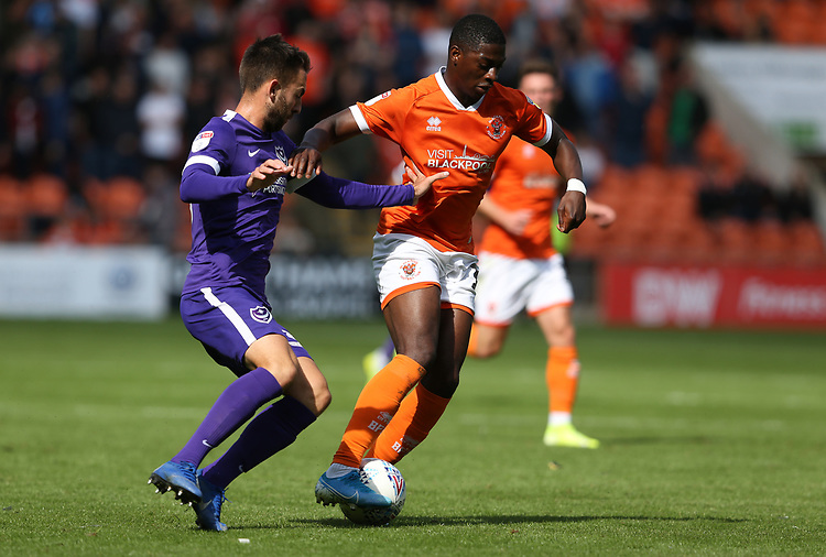 Blackpool's Sullay Kaikai shields the ball from Portsmouth's Ben Close<br /> <br /> Photographer Stephen White/CameraSport<br /> <br /> The EFL Sky Bet League One - Blackpool v Portsmouth - Saturday 31st August 2019 - Bloomfield Road - Blackpool<br /> <br /> World Copyright © 2019 CameraSport. All rights reserved. 43 Linden Ave. Countesthorpe. Leicester. England. LE8 5PG - Tel: +44 (0) 116 277 4147 - admin@camerasport.com - www.camerasport.com