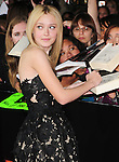 Dakota Fanning. at The Summit Entertainment's World Premiere of THE TWILIGHT SAGA: NEW MOON held at The Mann's Village Theatre in Westwood, California on November 16,2009                                                                   Copyright 2009 DVS / RockinExposures