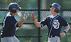 Greg Kwiecinski #2, St. Dominic shortstop, right, gets congratulated by Matthew Finn #5 after crossing home plate in the top of the second inning of a CHSAA varsity baseball game against Chaminade at Cantiague Park on Monday, May 16, 2016. St. Dominic won by a score of 14-3.