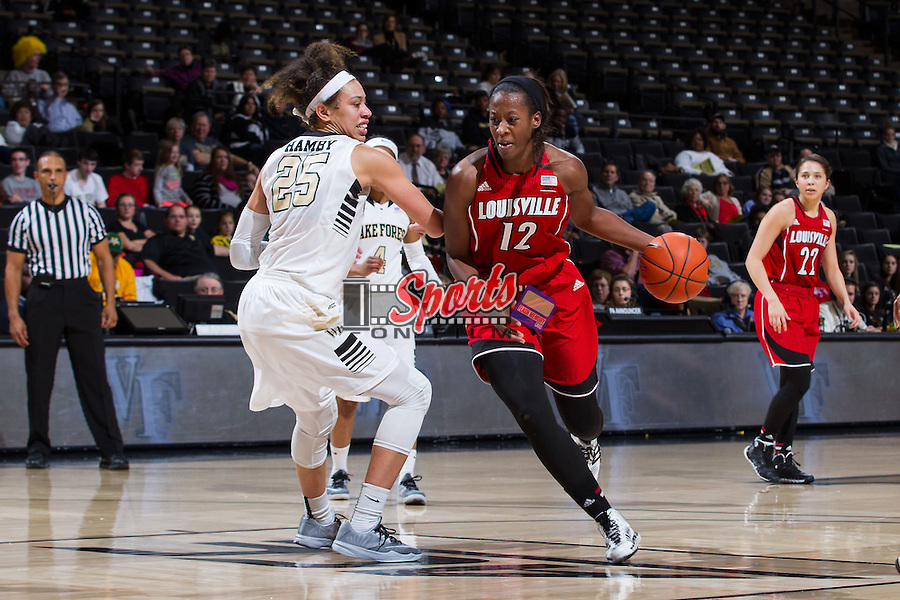 Shawnta' Dyer (12) of the Louisville Cardinals dribbles the ball past Dearica Hamby (25) of the Wake Forest Demon Deacons during second half action at the LJVM Coliseum on January 11, 2015 in Winston-Salem, North Carolina.  The Cardinals defeated the Demon Deacons 79-68.  (Brian Westerholt/Sports On Film)