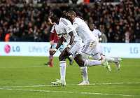 Pictured: Bafetimbi Gomis of Swansea celebrating his equaliser Saturday 10 January 2015<br />