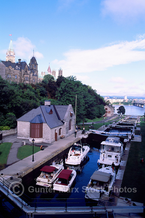 "Pleasure Boats in ""Ottawa Locks"" on Rideau Canal, Rideau Canal National Historic Site (UNESCO World Heritage Site and Canadian Heritage River), in the City of Ottawa, Ontario, Canada - Parliament Buildings on Parliament Hill beside Locks"