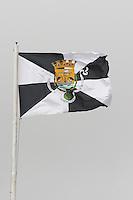 Lisbon flag fluttering on the Castelo de Sao Jorge fortress. Lisbon, Portugal