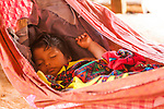 An indigenous Embera baby sleeps in a hammock in an Embera village in Panama. Chagres National Park