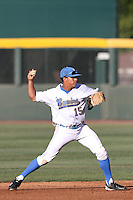 Kevin Williams #15 of the UCLA Bruins throws to first base against the Oregon State Beavers at Jackie Robinson Stadium in Los Angeles,California on April 29, 2011. Photo by Larry Goren/Four Seam Images