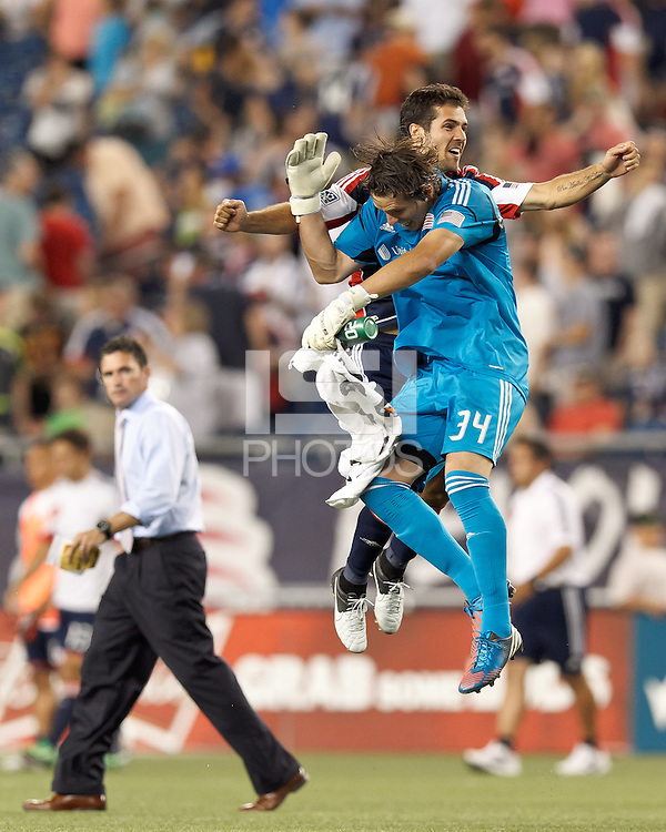 New England Revolution forward Benny Feilhaber (22) and New England Revolution goalkeeper Bobby Shuttleworth (34) celebrate Bobby Shuttleworth's shut-out as Jay Heaps looks on. In a Major League Soccer (MLS) match, New England Revolution defeated New York Red Bulls, 2-0, at Gillette Stadium on July 8, 2012.