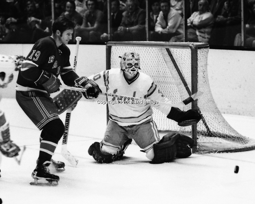 "Seals vs New York Rangers..Rangers Jean Ratelle and Seals goalie Gary ""The Cobra"" Simmons. (1974 photo/Ron Riesterer)"