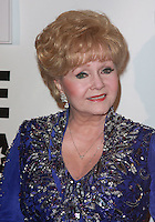 """28 December 2016 - Debbie Reynolds, the Oscar-nominated """"Singin' in the Rain,""""  singer-actress who was the mother of late actress Carrie Fisher, has died. She was 84. """"She wanted to be with Carrie,"""" her son Todd Fisher told Variety. She was taken to the hospital from Todd Fisher's Beverly Hills house Wednesday after a suspected stroke, the day after her daughter Carrie Fisher died. File Photo: 21 October 2007 - Beverly Hills, California - Debbie Reynolds. Thalians 52nd Anniversary Gala honoring Sir Roger Moore aka James Bond held at the Beverly Hilton Hotel. Photo Credit: Charles Harris/AdMedia"""