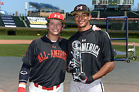National team member Chase Vallot (left) presents the home run derby champion trophy to Jacob Gatewood (right) before the Under Armour All-American Game on August 24, 2013 at Wrigley Field in Chicago, Illinois.  (Mike Janes/Four Seam Images)