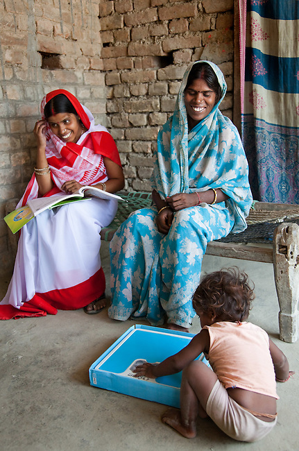 Bindu Devi with her son Sahil Kumar (right) and Anganwadi health worker Priya Kumari (left) in Bhagwanpuri Raiti  village after treatment at the local Anganwadi health clinic where oral rehydration salts (ORS) and zinc tablets are given out to combat the sometimes fatal effects of diarrhea.The village located in Vaishali district outside Patna in Bihar, India has been rolling out the ORS and Zinc program as part of the IKEA Social Initiative to combat child mortality rates caused by diarrhea. It is proving to be very successful with education and support provided by local nursing staff, health activists  and program officers from UNICEF. The treatment is a 14 day course administering diluted oral rehydration salts and a zinc tablet which is more effective than salts alone in combating the effects of severe diarrhea. Picture by Graham Crouch/UNICEF
