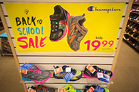 Back-to-school specials are advertised at a Payless ShoeSource store in New York on Thursday, July 31, 2014. Analysts are predicting a mediocre to poor back-to-school shopping season as retailers will be forced to heavily discount merchandise. The back-to-school shopping season is the second busiest time for retailers after Christmas. (© Richard B. Levine)