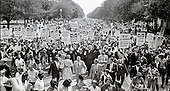 Leaders of the 1963 March on Washington for Jobs and Freedom raise their hands together as they move along Constitution Avenue in Washington, D.C. on August 28, 1963. Some of the leaders in the march, from left to right, include John Lewis, Mathew Ahmann, Roy Wilkins, Dr. King, Rabbi Joachim Prinz, A. Philip Randolph, and Whitney Young. <br /> Credit: Arnie Sachs / CNP
