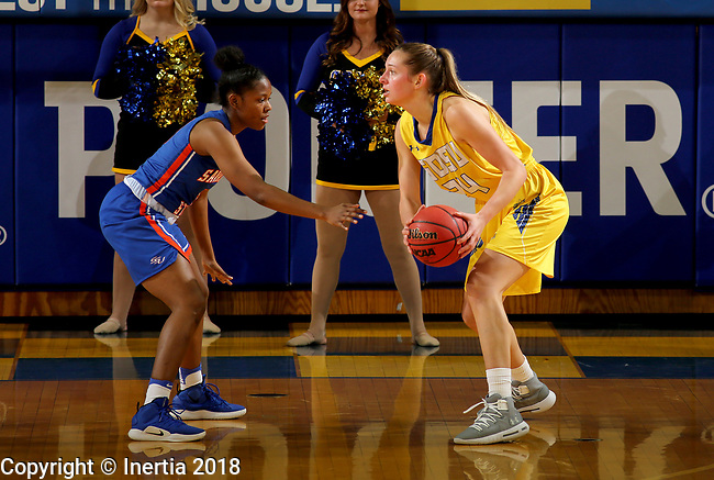 BROOKINGS, SD - DECEMBER 14: Tagyn Larson #24 from South Dakota State University looks to make a move against Heniaya Moton #3 from Savannah State Friday night at Frost Arena in Brookings, SD. (Photo by Dave Eggen/Inertia)