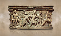 Roman relief sculpted sarcophagus of Aurelia Botiano and Demetria, 2nd century AD, Perge Inv 1.35.99. Antalya Archaeology Museum, Turkey.. Against a warm art background.