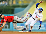 23 July 2011: Los Angeles Dodgers shortstop Rafael Furcal slides safely into second, toppling Danny Espinosa during play against the Washington Nationals at Dodger Stadium in Los Angeles, California. The Dodgers rallied to defeat the Nationals 7-6 on Furcal's walk-off, RBI double in the bottom of the 9th inning. Mandatory Credit: Ed Wolfstein Photo