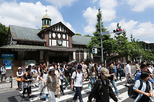 People walk past Harajuku Station on June 10, 2016, Tokyo, Japan. East Japan Railway Co. announced on June 8 plans to rebuild the almost century-old Harajuku Station with the project set to be completed in time for the 2020 Olympic Games. The current wooden structure is believed to be the oldest wooden station building in Tokyo and was build in 1924 with an European architectural style, and the new station will be larger with an extra platform and a new gate on the west side. It has not yet been decided if the old structure will also be preserved as part of the project. JR East also plans to reform Chuo-Sobu Line's Sendagaya and Shinanomachi  stations in time for the 2020 Games at a total cost of 250 billion yen (2.3 billion USD) for the whole project. (Photo by Rodrigo Reyes Marin/AFLO)