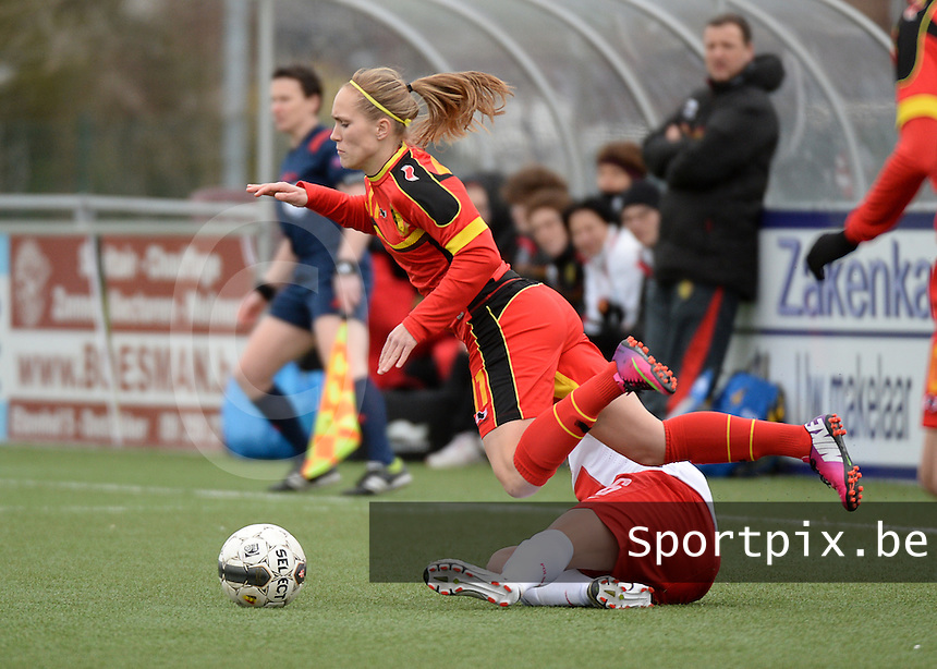 20140208 - OOSTAKKER , BELGIUM : Belgian Janice Cayman (l) pictured being Fouled during a friendly soccer match between the women teams of Belgium and Poland , Saturday 8 February 2014 in Oostakker. PHOTO DAVID CATRY