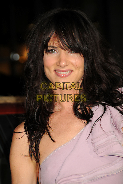 "JULIETTE LEWIS.""Due Date"" Los Angeles Premiere held at Grauman's Chinese Theatre, Hollywood, California, USA,.28th October 2010..portrait headshot fringe one shoulder lilac ruffles ruffle   purple smiling .CAP/ADM/BP.©Byron Purvis/AdMedia/Capital Pictures."