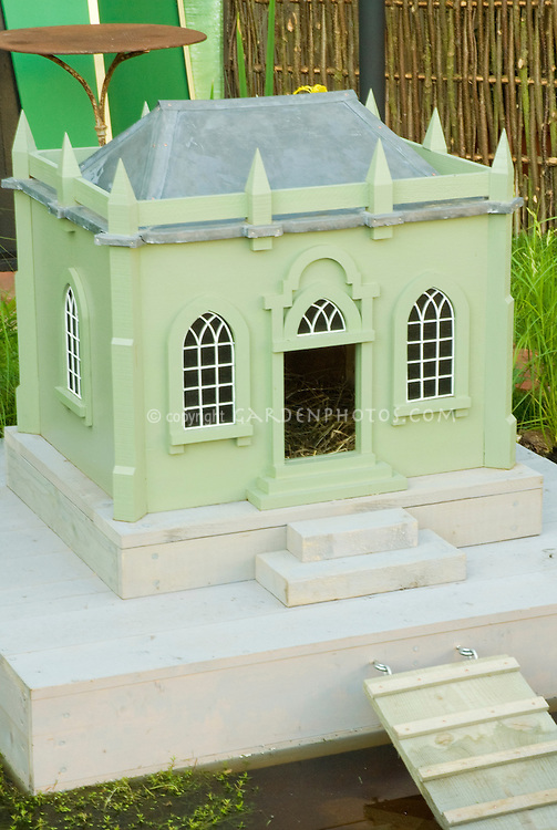 Cute fancy Chicken house made to resemble a manor house, for backyard poultry farm birds, with water moat and ramp