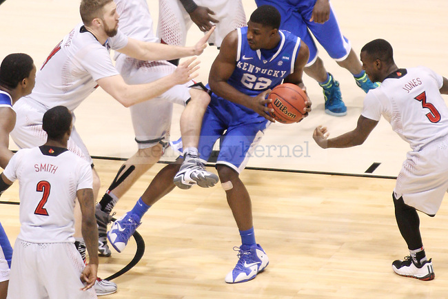 UK forward Alex Poythress (22) goes in for a basket while the UofL team tries to block him during the NCAA Sweet 16 vs. UofL at the Lucas Oil Stadium in Indianapolis , Ind., on Saturday, March 29, 2014. Photo by Eleanor Hasken | Staff