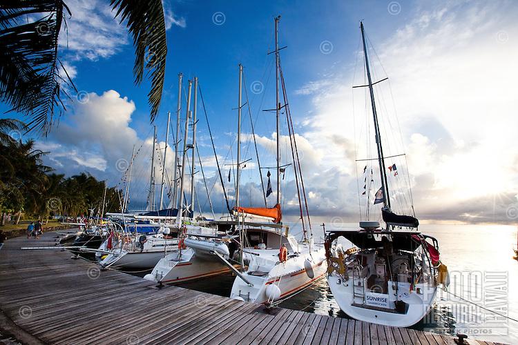 Couple walking past yachts at dock