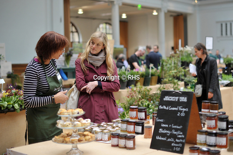 A visitor talks to an exhibitor at the Jammy Val stand at an RHS Secret Garden Sunday.