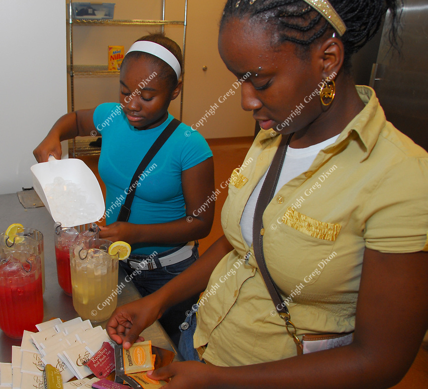 East High School junior Sheari Williams (left) and La Follette sophomore Santiah Funches prepare beverages at the new Atwood Community Center on Wednesday, August 20, 2008 in a program where local teens learn to prepare and present food