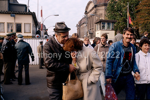 West Berlin, West Germany<br /> November 14, 1989<br /> <br /> East Germans become emotional as they cross the border from East Berlin into the West. Germans gathered as the wall is dismantled and the East German government lifted travel and emigration restrictions to the West on November 9, 1989.