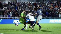 CARY, NC - DECEMBER 15: Paul Rothrock #3 of Georgetown University scores a goal past Colin Shutler #1 and Bret Halsey #13 of the University of Virginia during a game between Georgetown and Virginia at Sahlen's Stadium at WakeMed Soccer Park on December 15, 2019 in Cary, North Carolina.