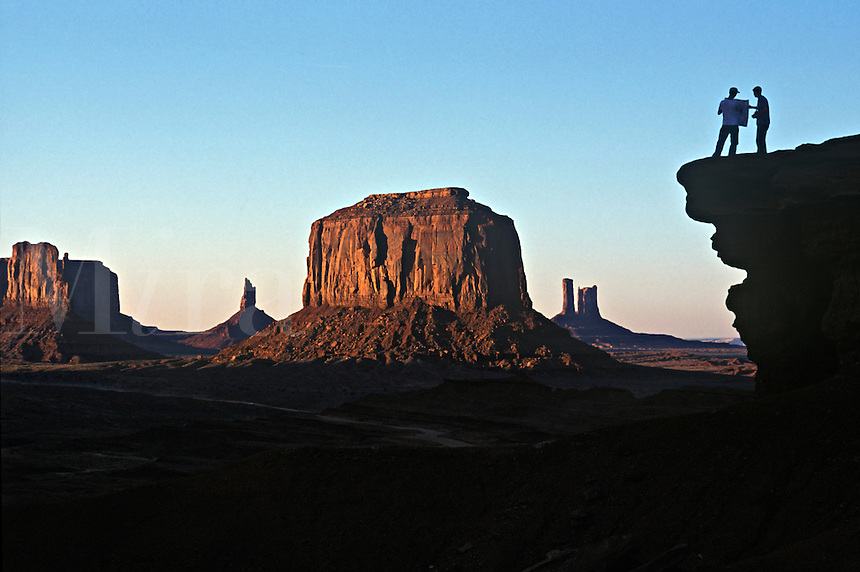Hikers look over a map in Monument Valley, Arizona