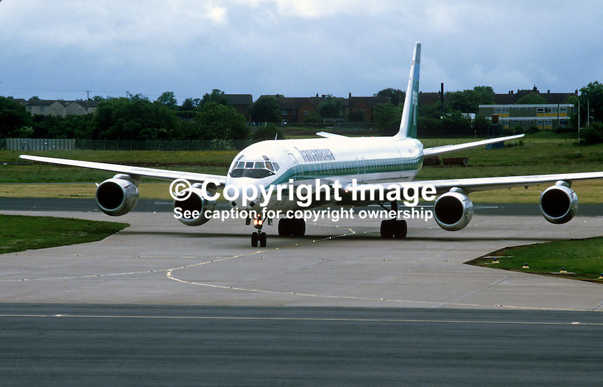 Inaugural Transamerica DC8 flight arriving Belfast International Airport from New York, USA, July 1985. 19850602TA1..Copyright Image from Victor Patterson, 54 Dorchester Park, Belfast, UK, BT9 6RJ..Tel: +44 28 9066 1296.Mob: +44 7802 353836.Voicemail +44 20 8816 7153.Skype: victorpattersonbelfast.Email: victorpatterson@me.com.Email: victorpatterson@ireland.com (back-up)..IMPORTANT: If you wish to use this image or any other of my images please go to www.victorpatterson.com and click on the Terms & Conditions. Then contact me by email or phone with the reference number(s) of the image(s) concerned.